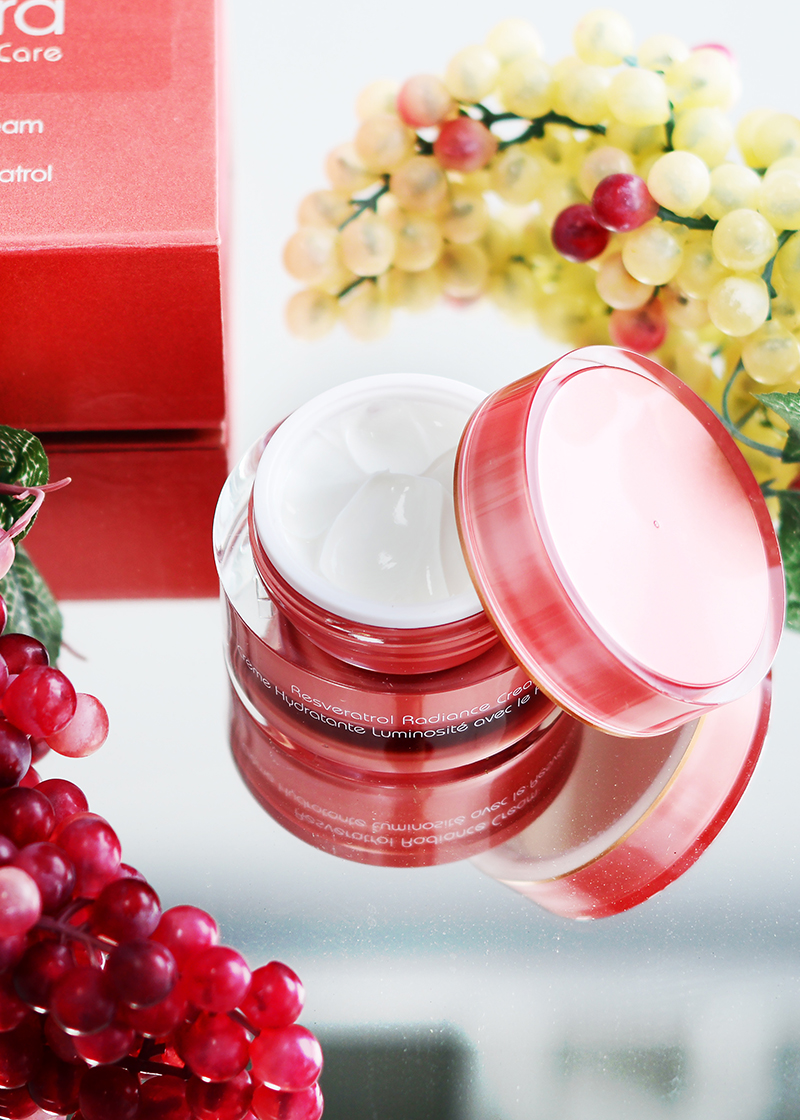 Resveratrol Radiance Cream SPF 30 with a background